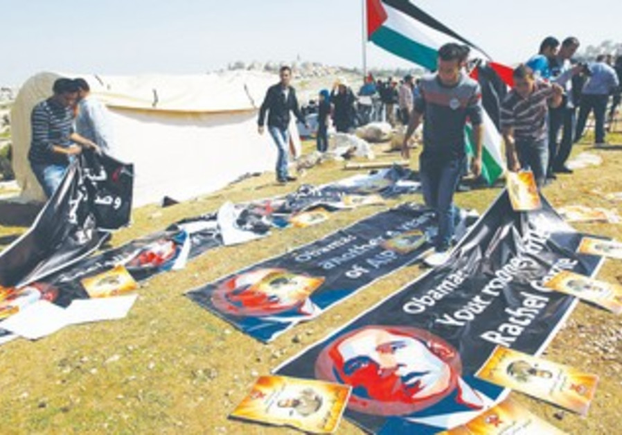 Palestinians organize banners protesting Obama visit at E1 encampment, March 20, 2013.