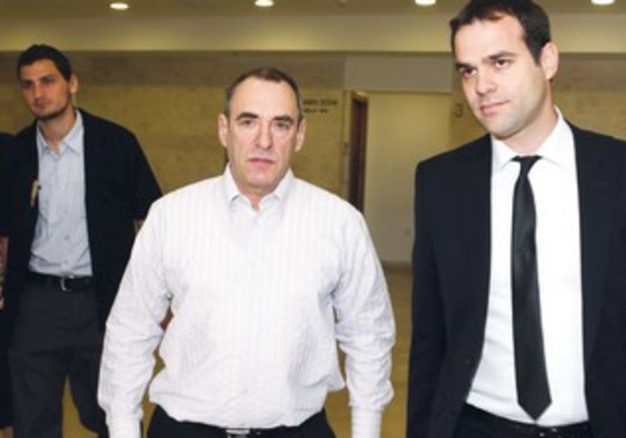 FORMER REMEDIA technologist Frederick Black (center) leaves Petah Tikva Magistrate's Court