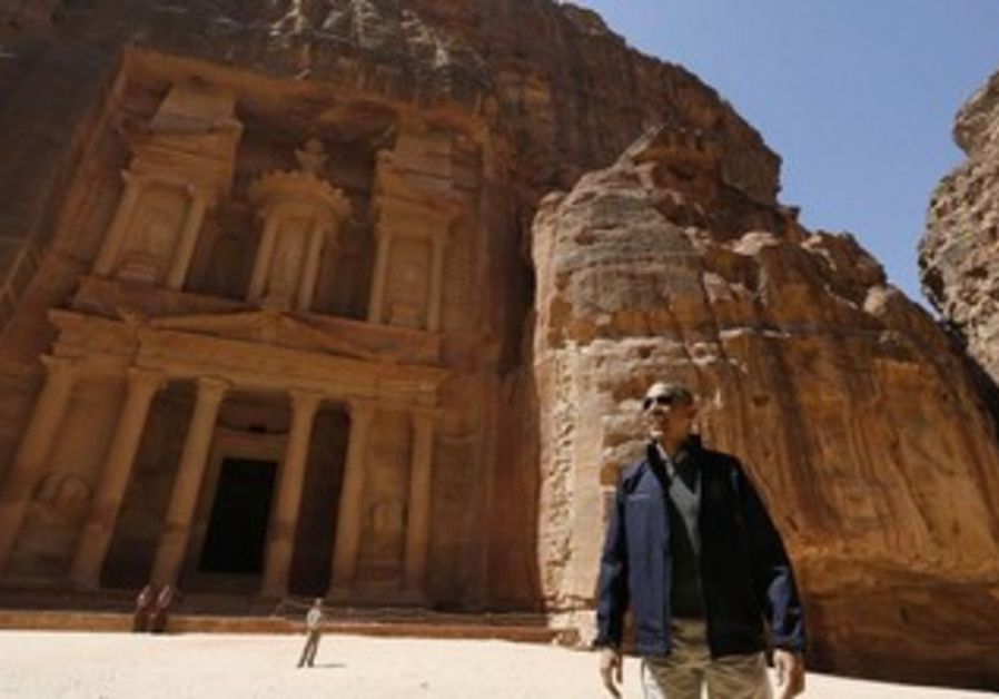 US President Obama stops to look at the Treasury as he takes a walking tour of Petra, March 23