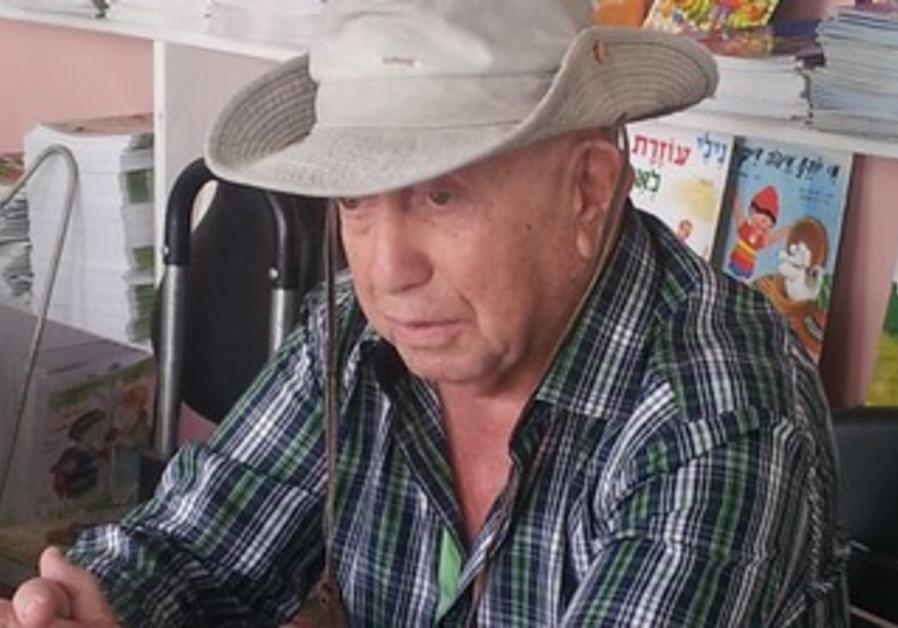 SHLOMO ALUF sits in his bookstore in Petah Tikvah.