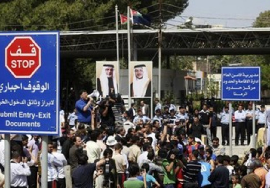 Jordanians shout during a protest in solidarity with the protesters in Syrian town of Deraa, 2011.