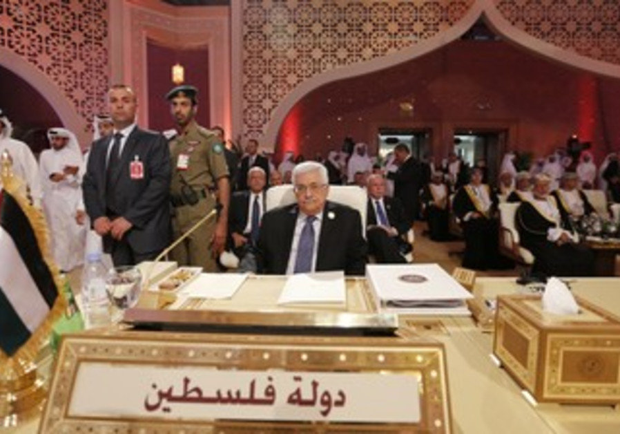 PA President Mahmoud Abbas looks at Arab League summit, Doha