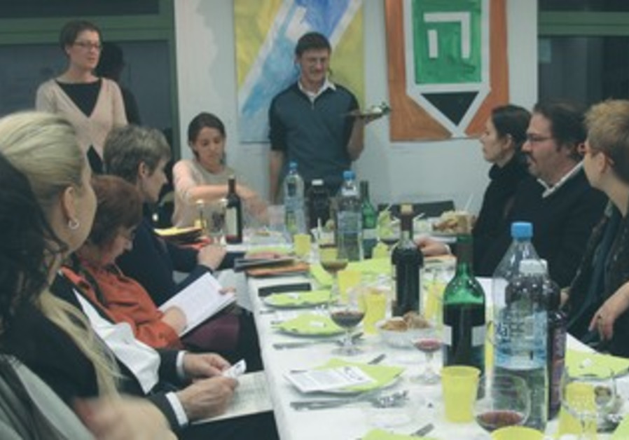 PEOPLE ATTEND the Passover Seder at the Jewish Community Center in Krakow, March 25