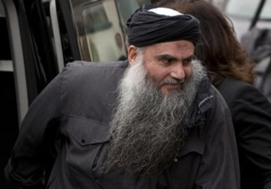 Abu Qatada arrives back at his home after being released on bail, in London, November 13, 2012.