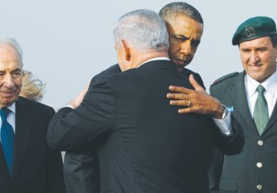 PRIME MINISTER Binyamin Netanyahu greets US President Barack Obama.
