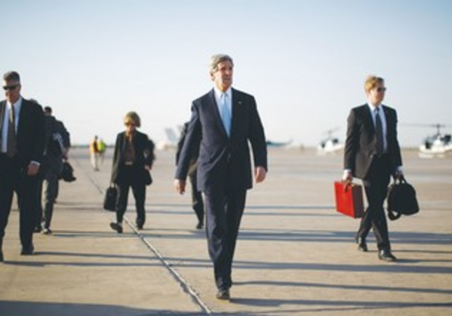 US SECRETARY OF STATE John Kerry walks on the tarmac in Kabul on Monday.