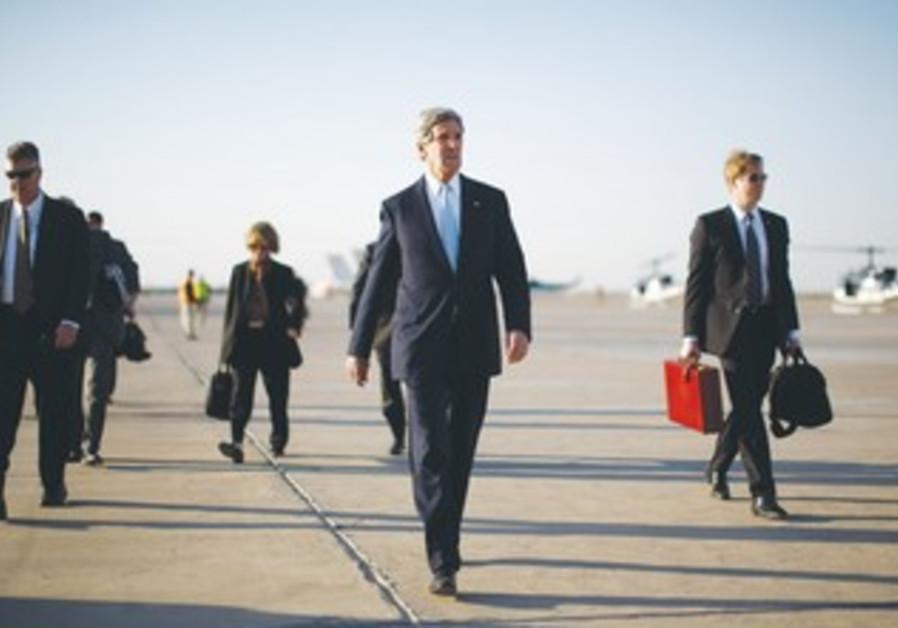 US SECRETARY OF STATE John Kerry walks on the tarmac in Kabul on Monday.