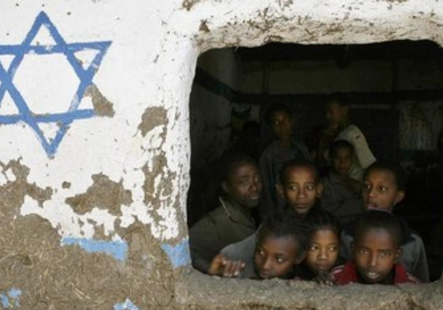 Ethiopian children look out of a window at Beta Israel school in Ethiopia.