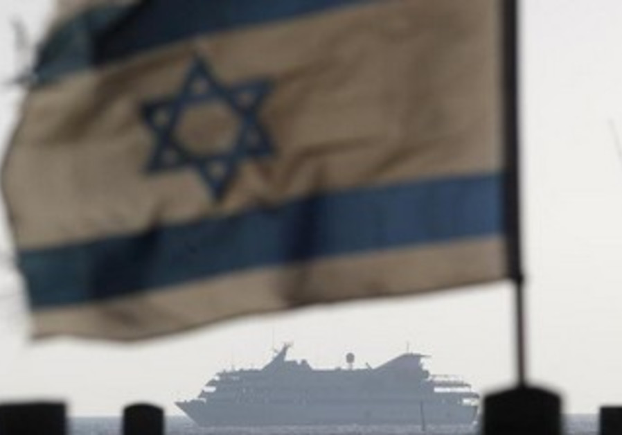 Israeli flag flutters as Mavi Marmara escorted to Ashdod port May 31, 2010.