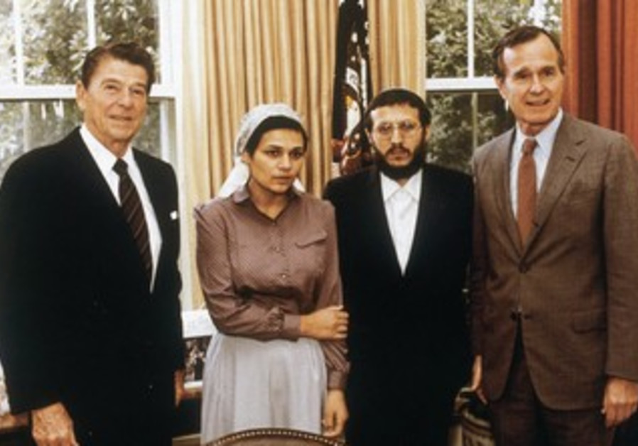 US PRESIDENT Ronald Reagan and vice president George Bush meet with Yosef Mendelevich