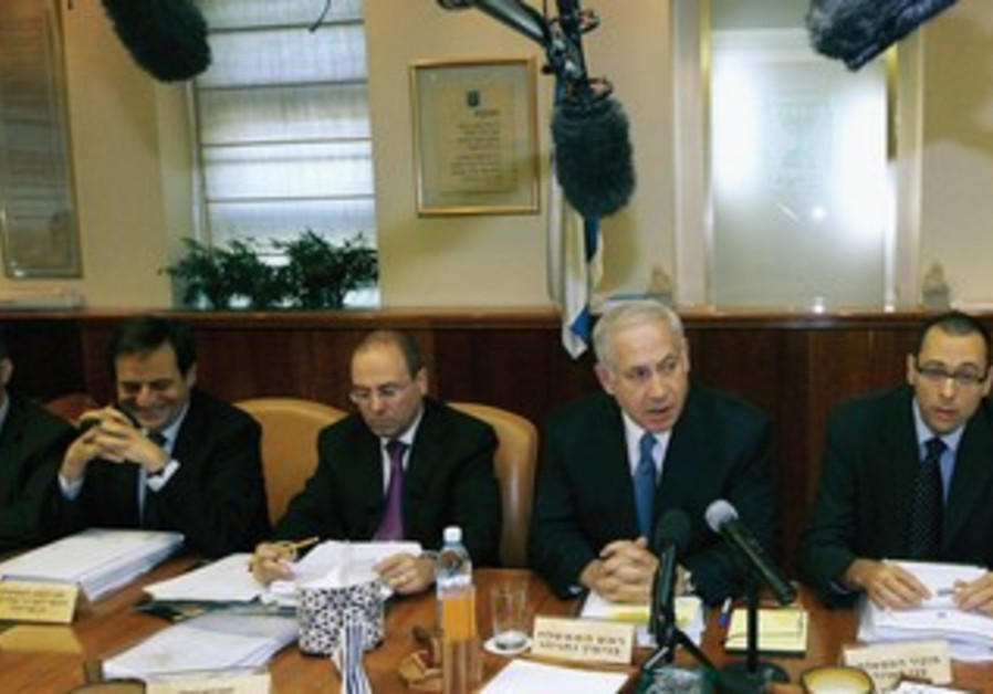 Netanyahu sits with his cabinet in 2009.