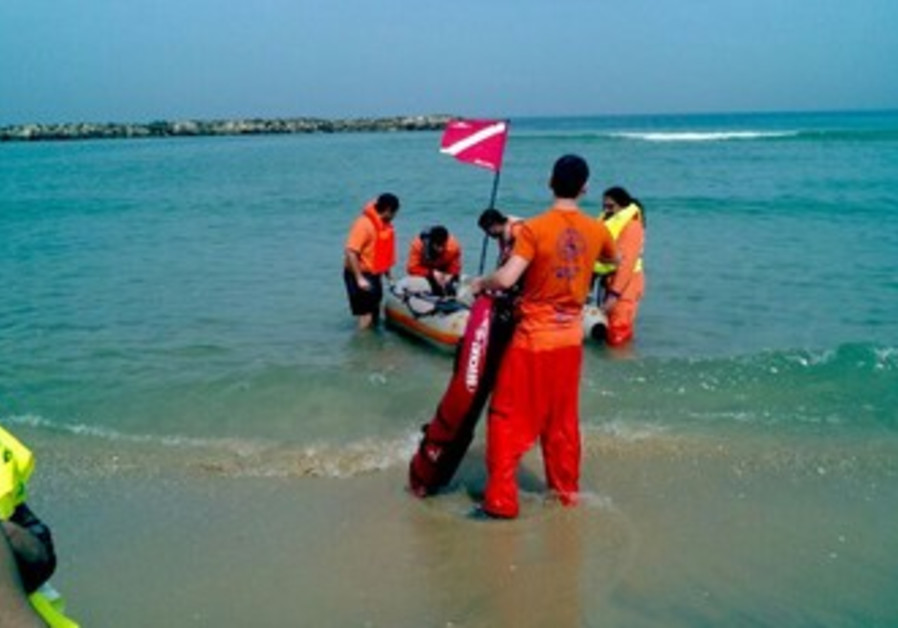 ZAKA rescuers search Ashkelon Coast  for missing brothers