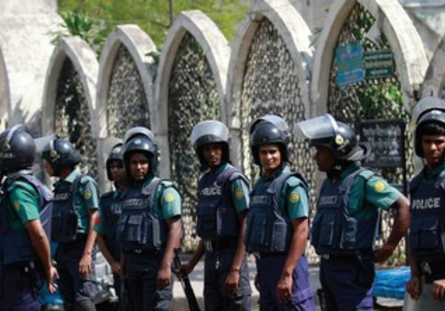 Police in Bangladesh cordone off a street during protests and riots in the country.