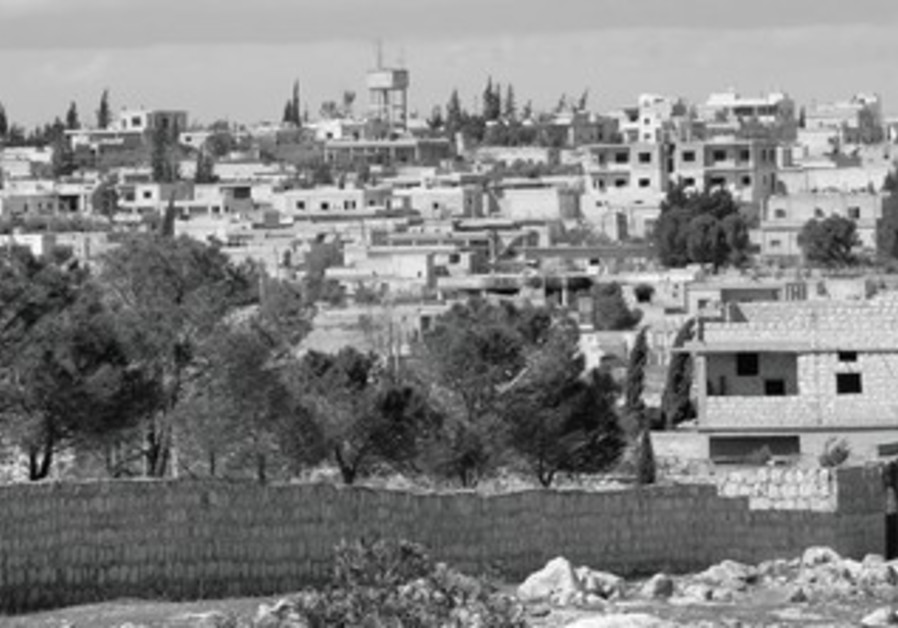 A VILLAGE in Syria where rebel commanders assert that Syria's government used chemical weapons.