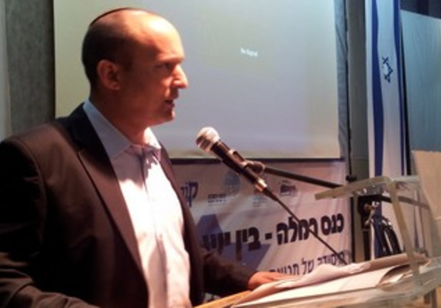 Economics and Trade Minister Naftali Bennett speaking at Ramla conference, April 2, 2013.