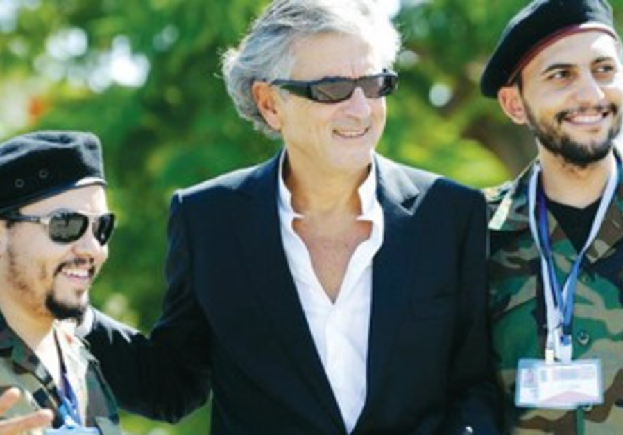 BERNARD-HENRI LÉVY with Libyan insurgents.