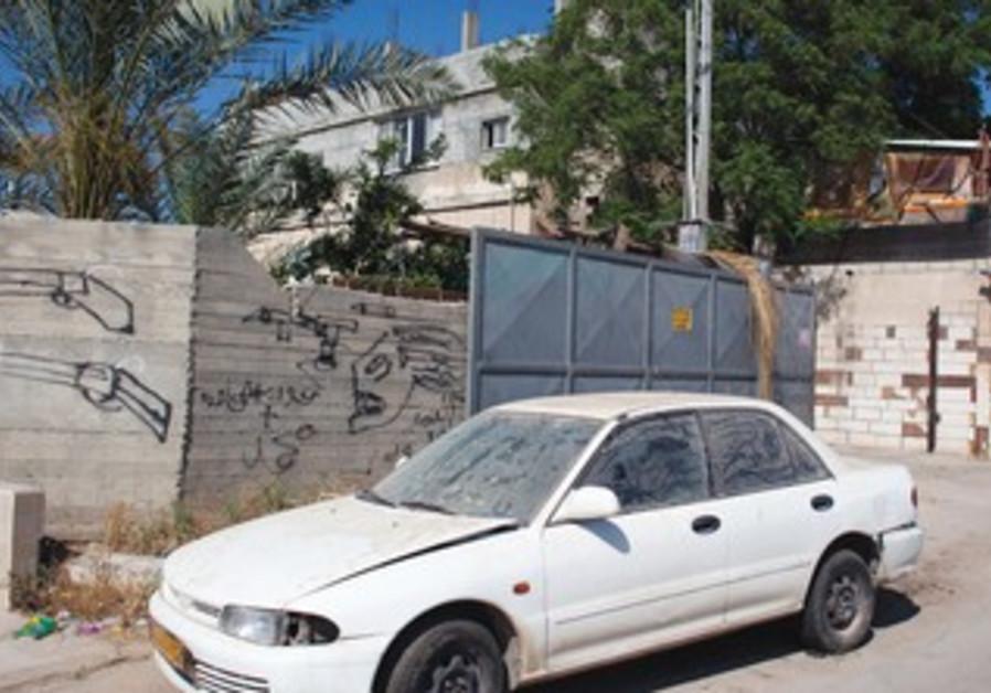 GRAFFITI IN an Arab neighborhood of Lod depicts guns.