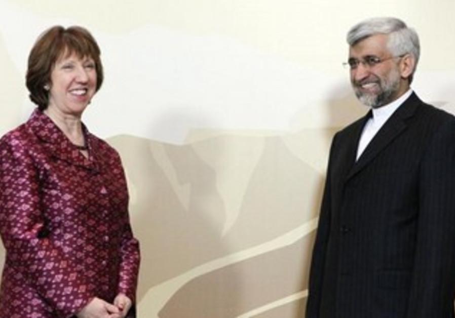 Iranian negotiator Saeed Jalili and EU's Catherine Ashton at nuclear talks, April 5, 2013.