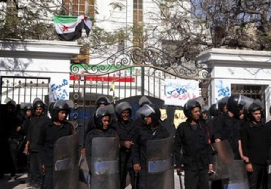 Police outside the Iranian ambassador's house during a protest against Iran in Cairo April 5, 2013.