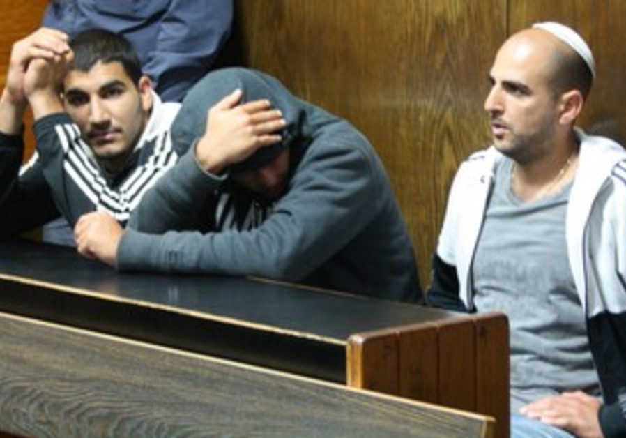 Dror and Omer Alperon in court, April 5, 2013.