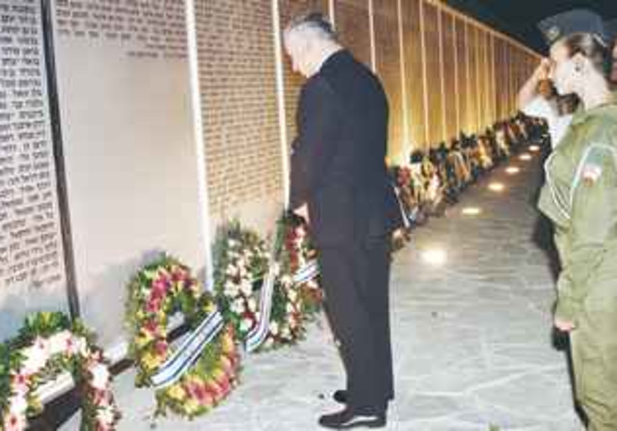NETANYAHU lays a wreath at the Armored Corps memorial in 1996.