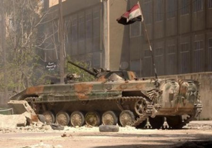 A Syrian Army tank bearing a Syrian national flag