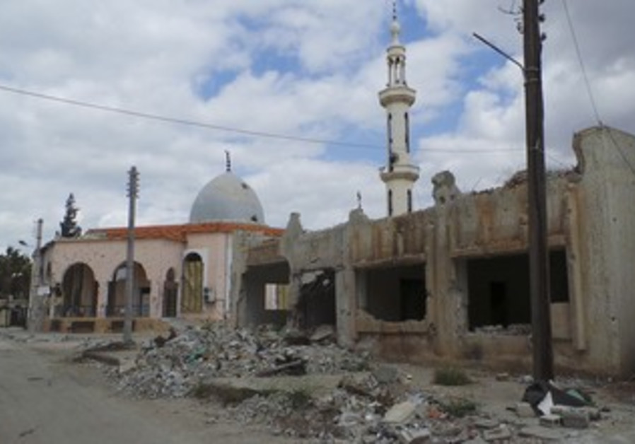 A view shows damaged mosques and properties which activists said were damaged by shelling