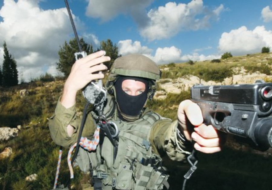 A counter-terrorism instructor holds his weapon at the IDF's Mitkan Adam base near Modi'in.