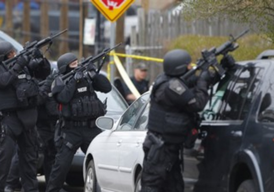 Police in Boston suburb Watertown looking for second suspect in marathon bombing, April 19, 2013.