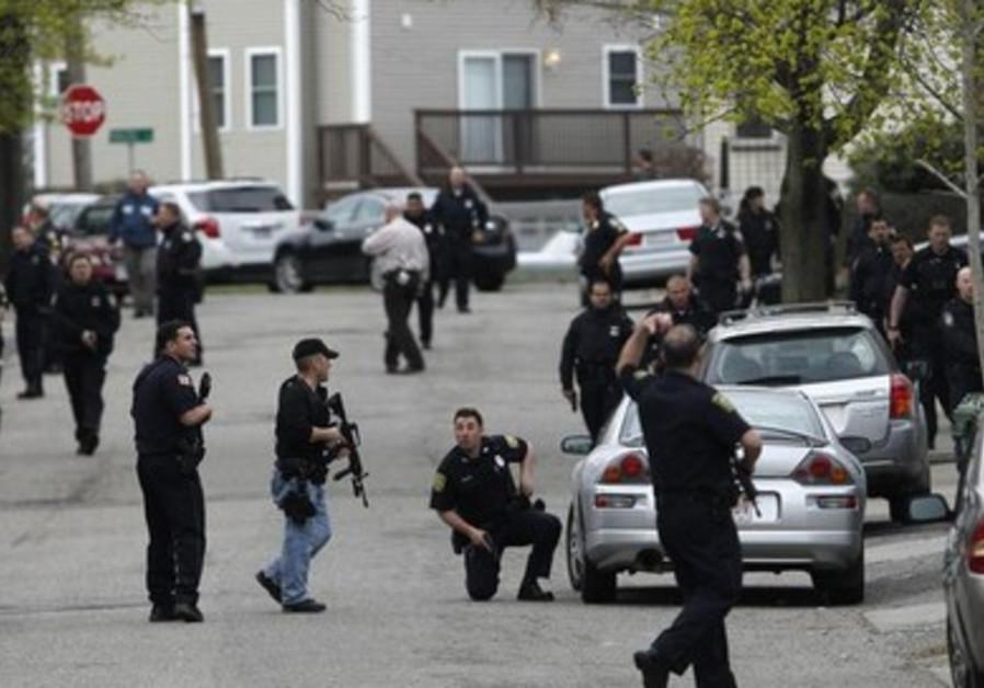 Boston police search for suspect.