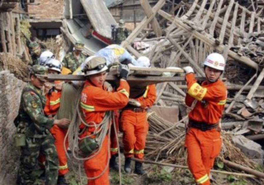 Rescue workers remove an elderly person from a collapsed building.