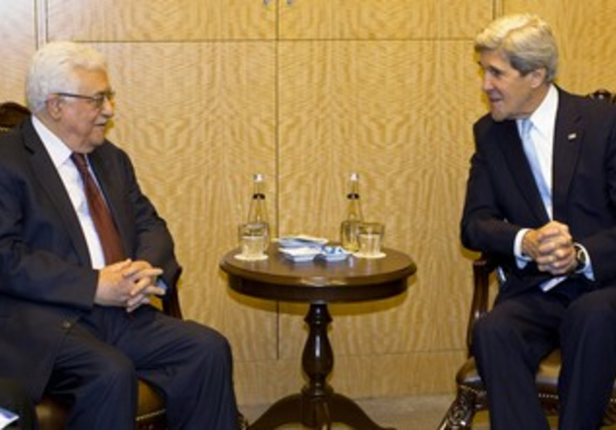 US Secretary of State John Kerry and PA President Mahmoud Abbas meet in Istanbul, April 21, 2013.