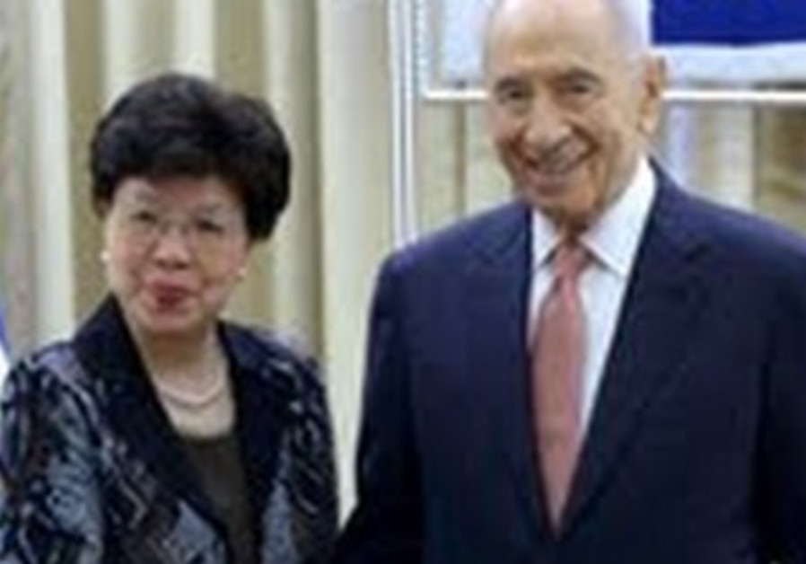 WHO Secretary General Dr. Margaret Chan and Preseident Shimon Peres.