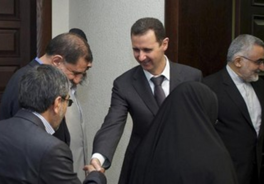 Syrian President Bashar Assad meeting with a Lebanese delegation, April 22, 2013.