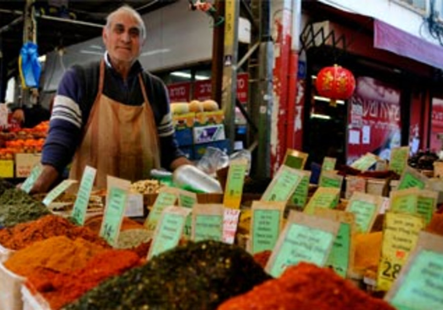 A spices vendor at Carmel Market