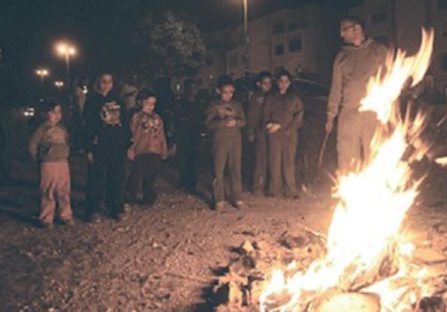 CHILDREN GATHER around a Lag Ba'omer bonfire last year
