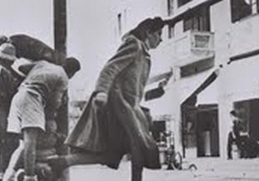 TEL AVIV PASSERSBY DODGING HASSAN BEK SNIPER FIRE, February 25, 1948