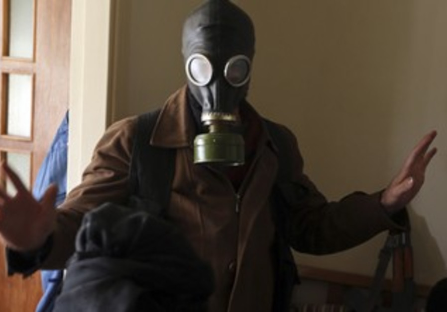A fighter from the Free Syrian Army wears a gas mask in January 2013.
