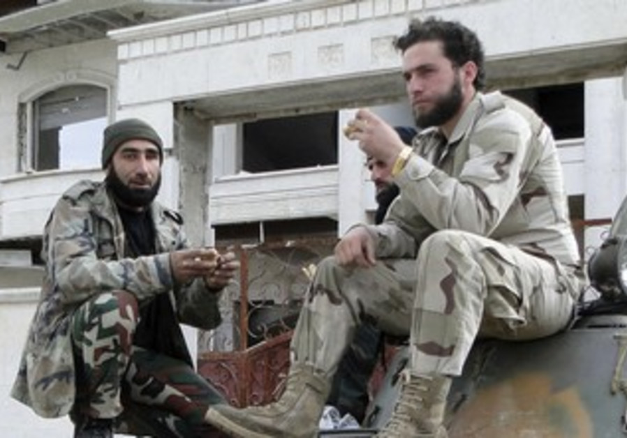 Free Syrian Army fighters eat atop an armoured personnel carrier, March 4, 2013
