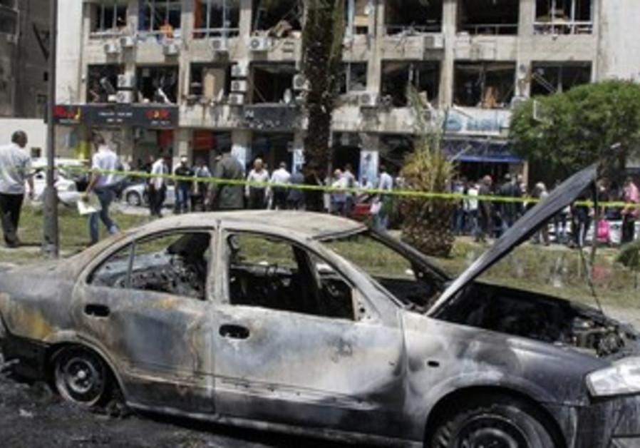 Bomb strikes in Damascus, kills 13.