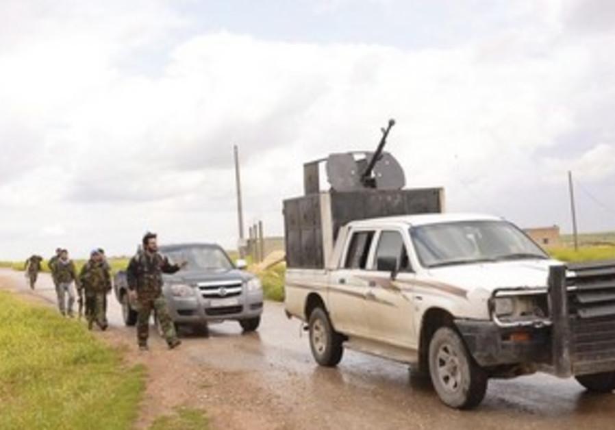 FORCES LOYAL to Syria's President Bashar Assad