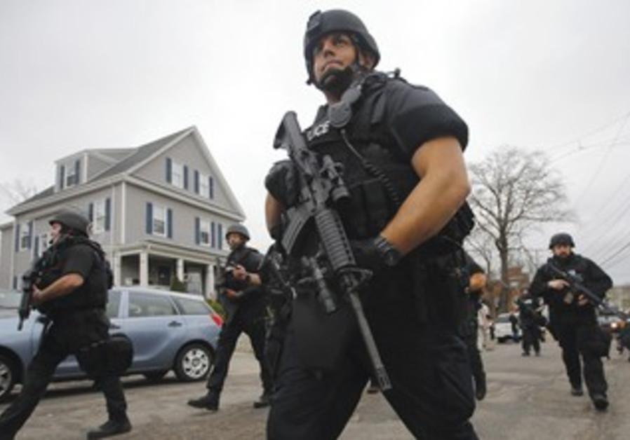 Police take part in man hunt for Boston Marathon bombing suspect Dzhokhar Tsarnaev.