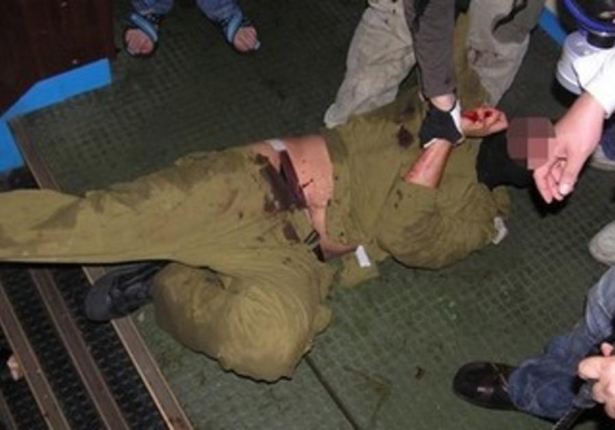 Israeli soldier attacked by Mavi Marmara passengers