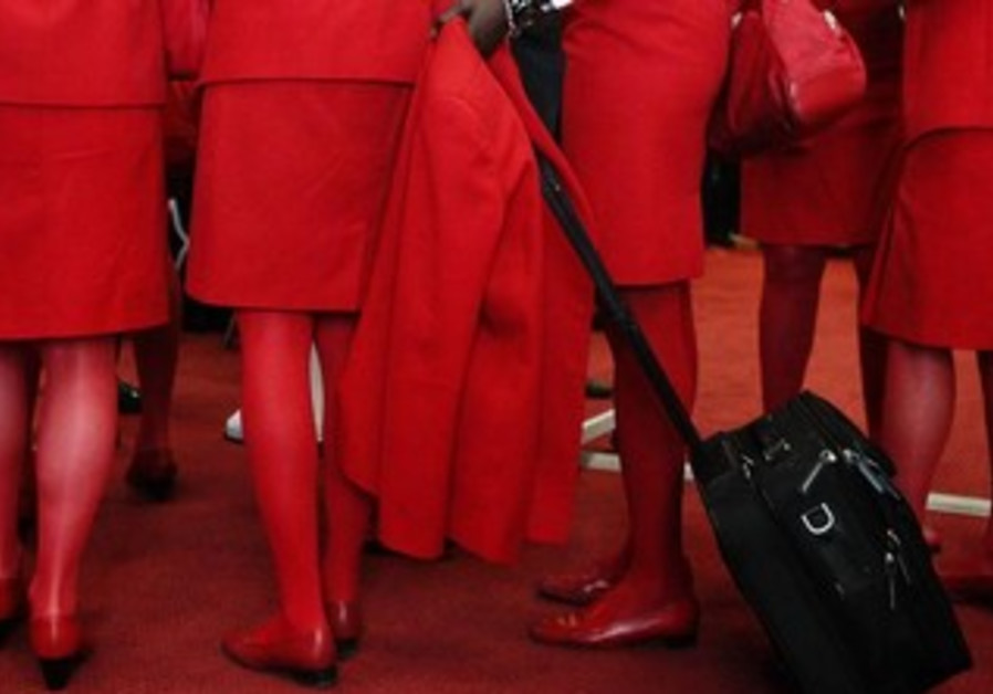 Airline stewardesses wearing red