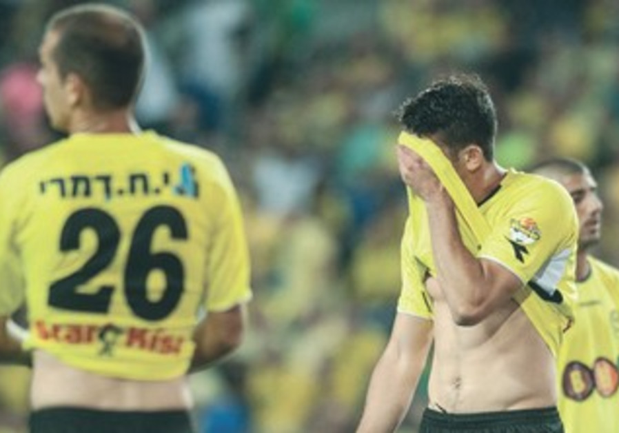 Maccabi Netanya players in disbelief after relegation