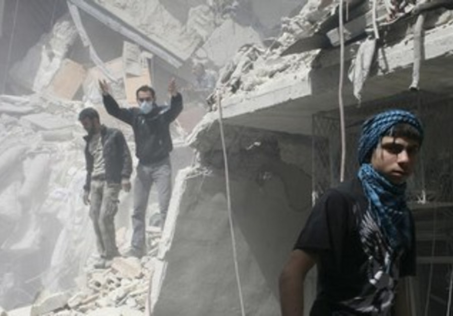 People search for survivors in the rubble in a damaged area in Syria