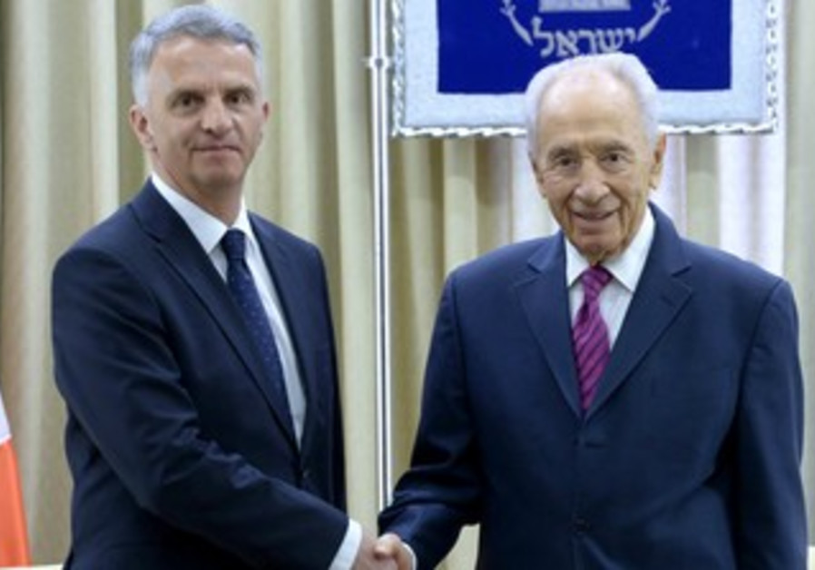 President Shimon Peres and  Swiss Foreign Minister Didier Burkhalter.
