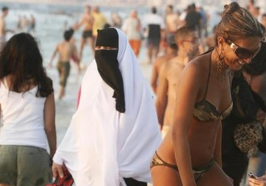 A secular woman enjoys the beach in Alexandria, Egypt