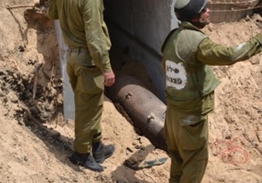 IDF officials prepare to detonate the bomb
