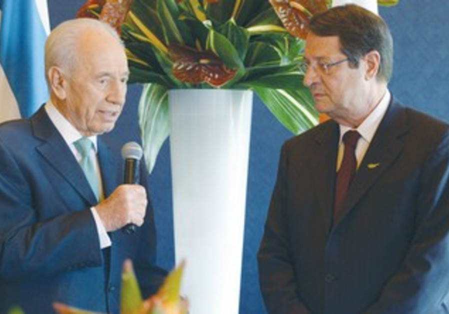 President Shimon Peres with Cypriot counterpart Nicos Anastasiades, May 2013.